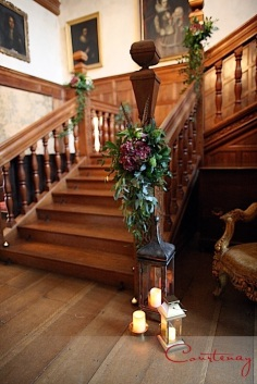North Cadbury Court Country House Winter Wedding Berry Wine Colours Decor Feathers Lanterns Stairs Flowers Candles