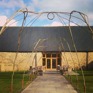 Hand built hazel and willow arches made with locally sourced materials for Wick Farm Bath