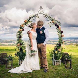 Vintage, Cream, metal arch, adorned, decorated, dressed, floral, flowers and plants, lanterns, fairy lights, quantocks, view, Hunstile Organic Farm