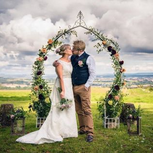Vintage, Cream, metal arch, adorned, decorated, dressed, floral, flowers and plants, lanterns, fairy lights, quantocks, view, Hunstile Organic Farm